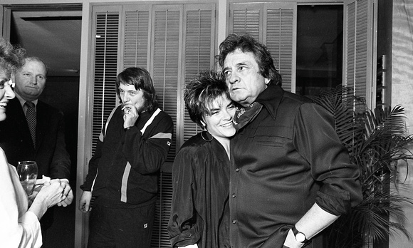 Rosanne Cash and her father Johnny Cash, with Waylon In the back ground